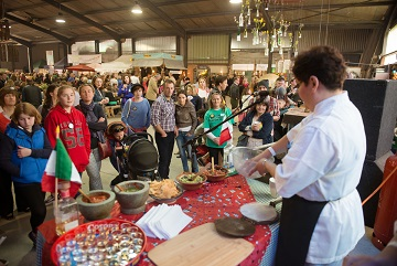 Carmen and Lupita give a Mexican cookery demonstration in the Big Shed